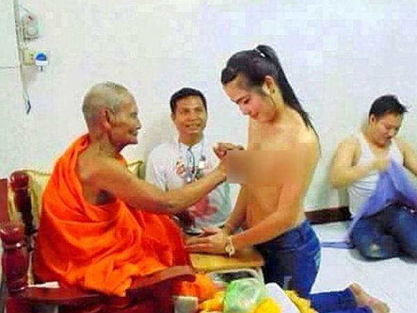 Buddhist monk is criticised for fondling a naked woman's breasts