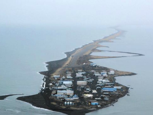 This is climate change: Alaskan villagers struggle as island is chewed up by the sea