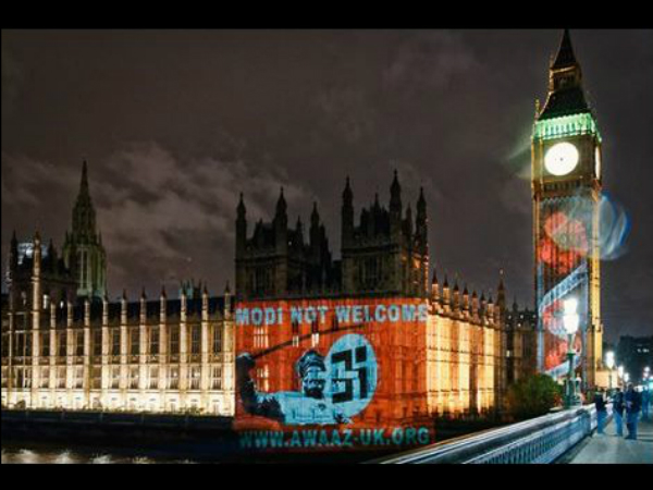 'Modi not welcome' in UK: Photo beamed on British Parliament with Swastika, sword