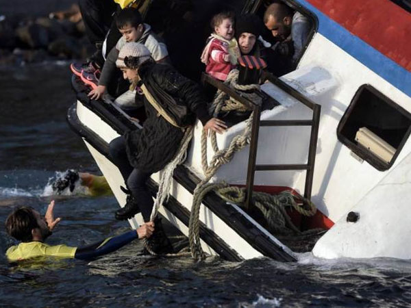 Six children among 21 dead as two migrant make shift wooden sailboats sink off Greek islands