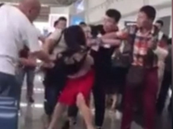 Hands off my man! Enraged wife beats and drags around husband's 'mistress' after catching 'cheating couple' on holiday