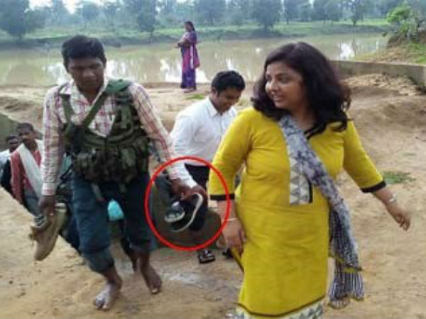 Female Collector Makes Security Guard Hold Chappals While Ri