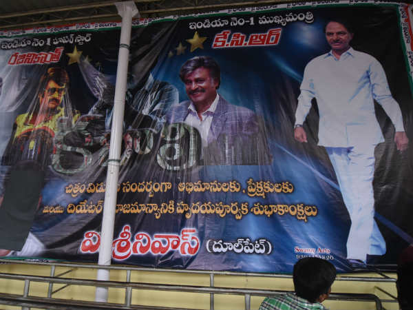 Kabali poster with cm kcr at sudarshan 70mm theatre at rtc cross roads