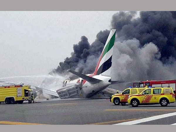 Dubai airport fire: Emirates plane in flames on runway after 'crash landing'