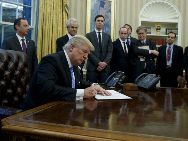Trump signs executive order to keep out 'radical Islamic terrorists'