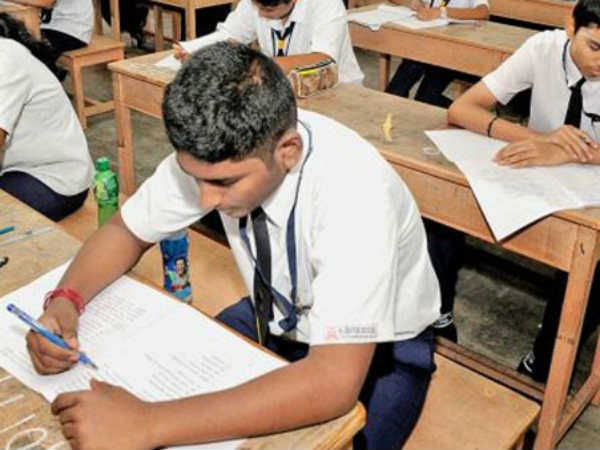 Parents give higher secondary exam alongside son