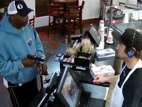 Watch Cashier Has The Most Calm Reaction Being Robbed At Gunpoint