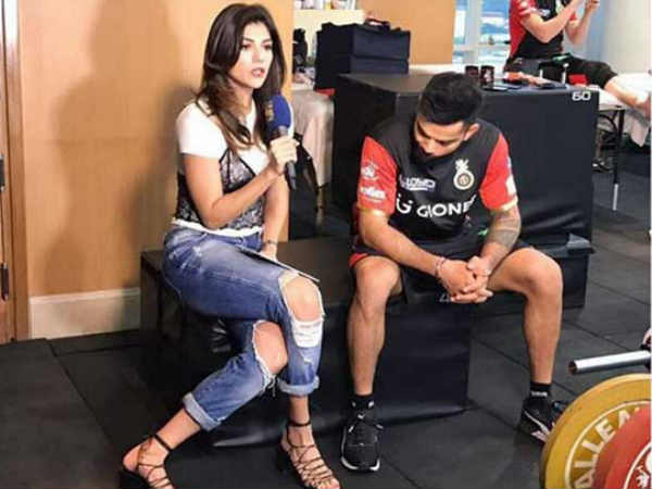 Virat Kohli caught ogling at IPL host Archana Vijaya's ripped jeans in badly timed photo goes viral