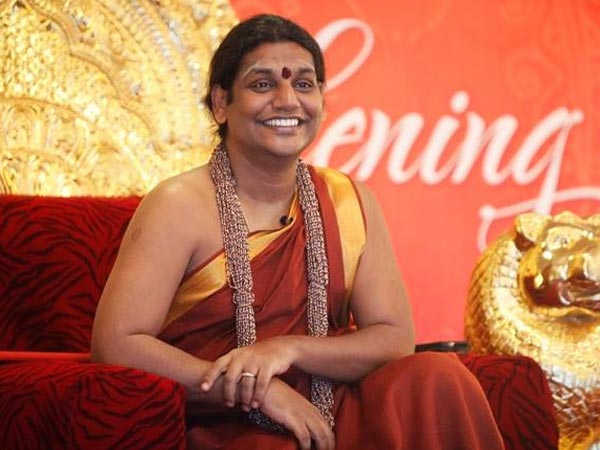 Police chase away Nithyananda disciples from occupying site at Tiruvannamalai.