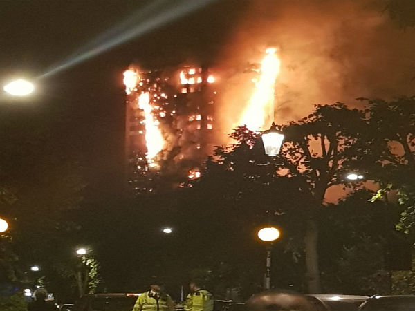 Fire engulfs a tower block in Latimer Road in West London
