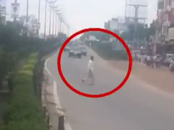 Caught On Cam Cop Slaps Man Crossing Road As Cm Chandrababu Convoy