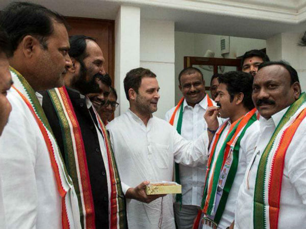 Rahul gandhi offered revanth to sweet with left hand