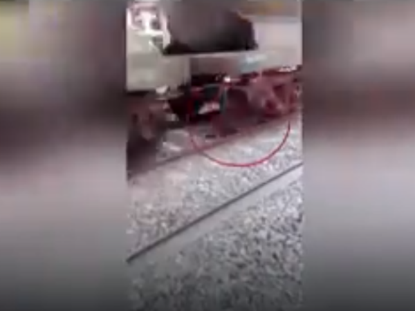 Miracle man walks away unhurt after a goods train passes over him