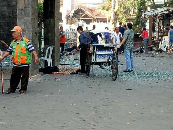 At least 10 killed in 3 church bombings in Indonesia