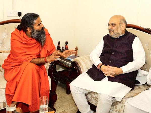 Amit Shah meets Yoga guru Ramdev as part of BJPs outreach exercise