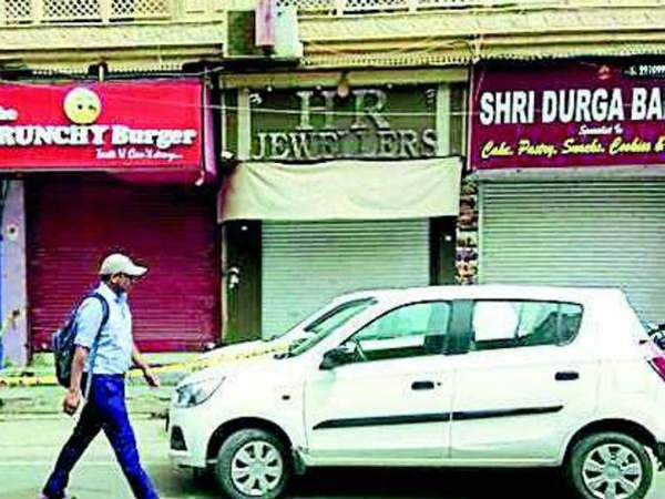 Jewellery owner shot dead in front of his son