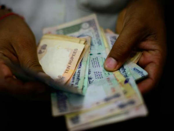 Rupee hits 19 month low against US dollar as crude oil prices rise