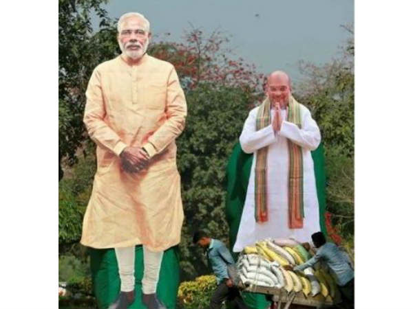 Modi and Shah cut outs used as scarecrows in Karnataka fields
