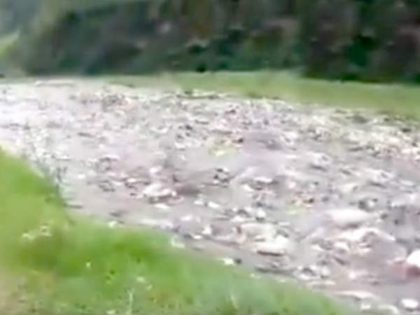 A small rain, River in Himalayas is filled with plastic and trash