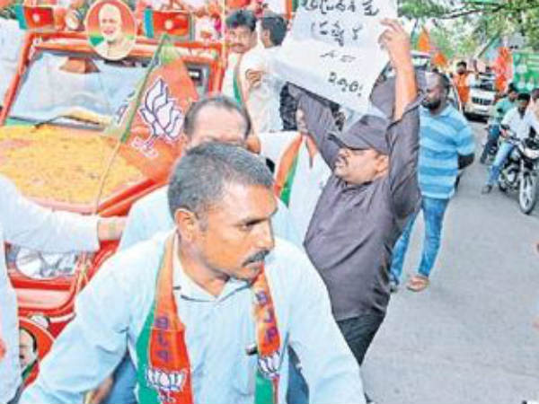 a man roughed up at state bjp chiefs event, for protest over special status