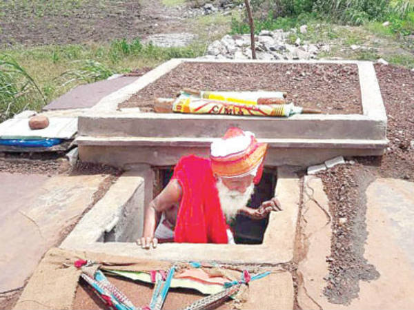 Septuagenarian attempts to bury self to reach God