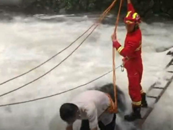 Driver Rescued From Middle Of Flooded River In China