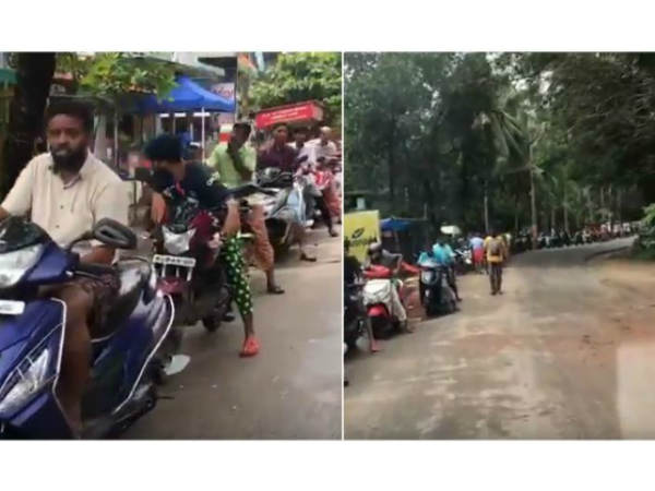 Floods aftermath:These people wait with patience for hours to fill their petrol tanks