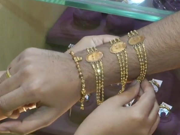These golden Rakhis with Modi,Yogi photos are hot cakes in Surat