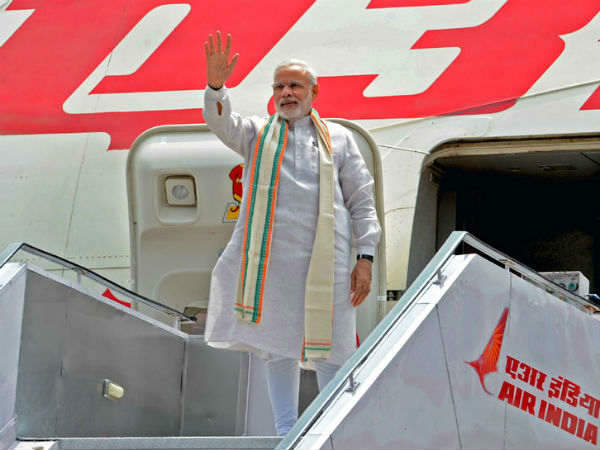 Disclose names of private persons who accompanied PM Modi on foreign tours: CIC to MEA