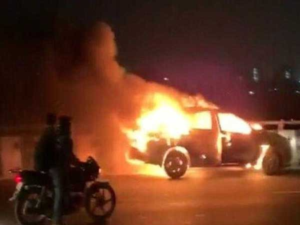 Fire emerges from a car in Gurugram,man jumps off the car