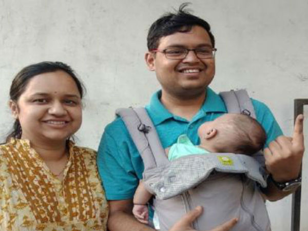 young couple cast their vote with 3 months baby in nagpur