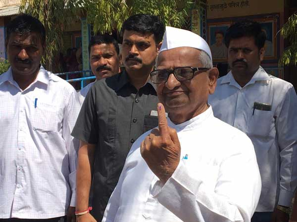 Social activist Anna Hazare in Maharashtra and Narendra Modis mother, Heeraben in Gujarat cast their Votes