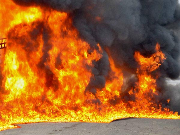 a govt teacher set fire his own house