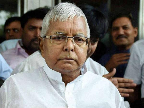 complaint to EC against lalu for distributing RJD tickets despite being in jail