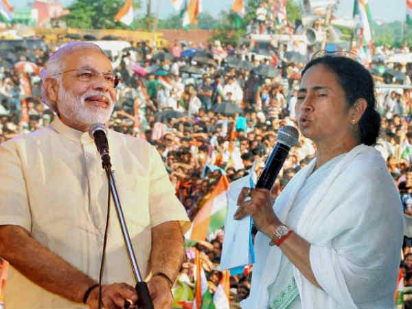 Scared Of Her Own Shadow PM Modi Targets Mamata Banerjee At Bengal Rally