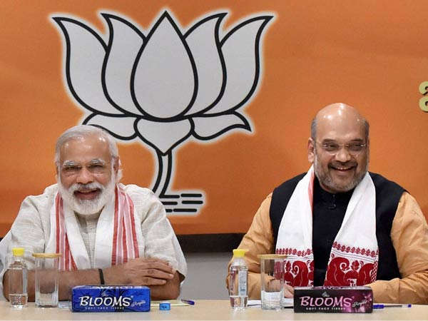 In his first-ever press conference, PM Modi directs all questions to Amit Shah