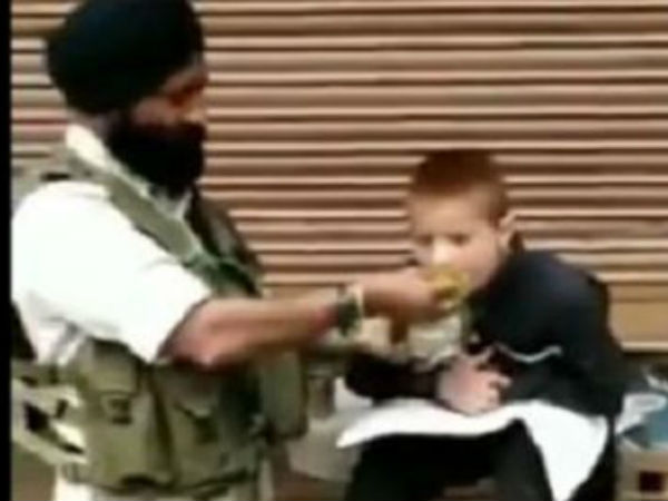 CRPF Soldier feeds his lunch to paralytic child in srinagar