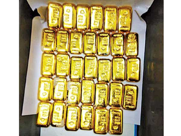 three kg above gold seized from singapore person at shamshabad airport