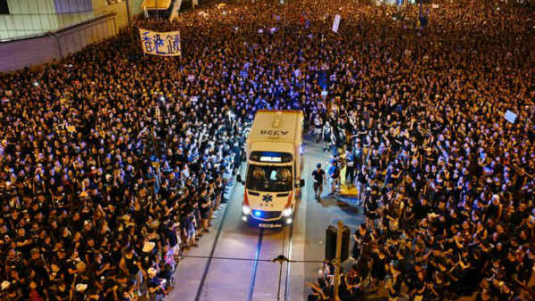 Hong Kong protesters let an ambulance go through the massive protest