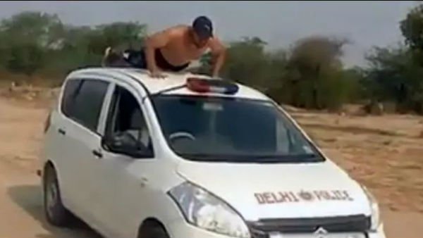 A TikTok video showing a man performing dangerous stunts on a dummy Delhi Police car