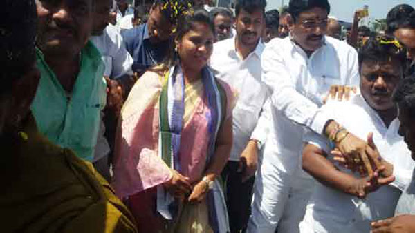 AP Deputy CM Pushpa Srivani have a narrow escape after a stage collapse
