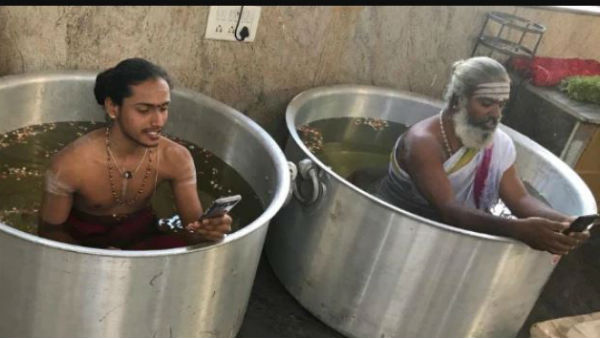 priests performed puja for early monsoon sitting in vessels filled with water.