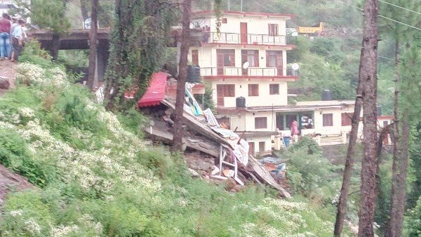 more than 30 people are feared stuck under the a guest house building collapsed