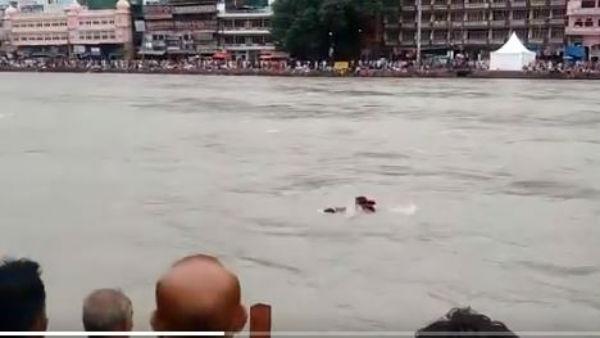 శభాష్ పోలీస్.. నదిలో కొట్టుకుపోతున్న వ్యక్తి సేఫ్..! (వీడియో)