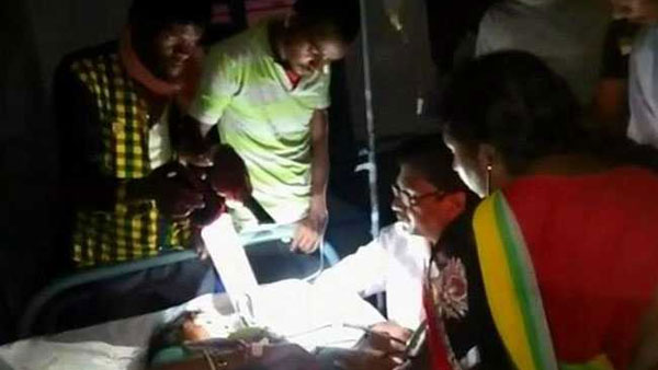Power cuts make doctors treat patients under flashlights