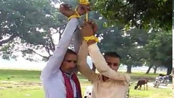 Father and son thrashed, made to do sit ups by locals