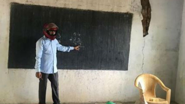 government teacher protest with helmet wearing in class room