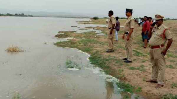 family washed in river.. one dead, another missing