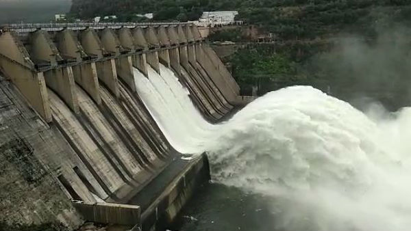 srisailam project four gates lifted ministers special pujas to krishnamma
