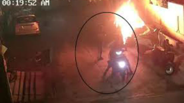 unknown persons set fire to car and some bikes at mid night in Vijayawada